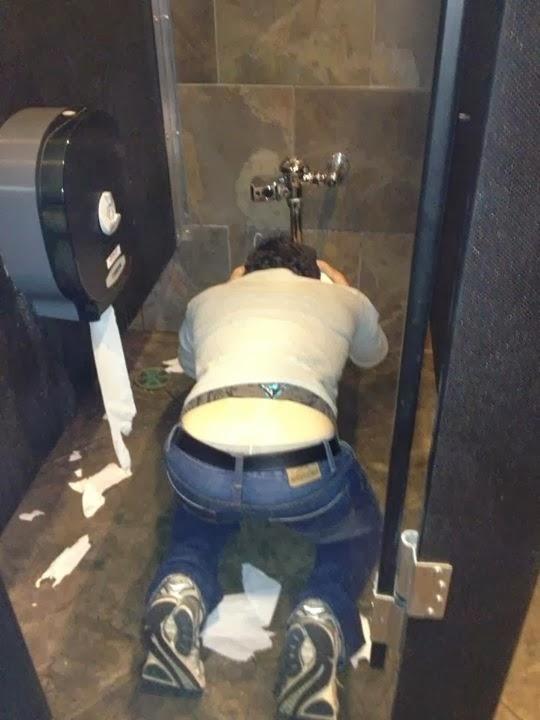 puking-in-toilet-bowl